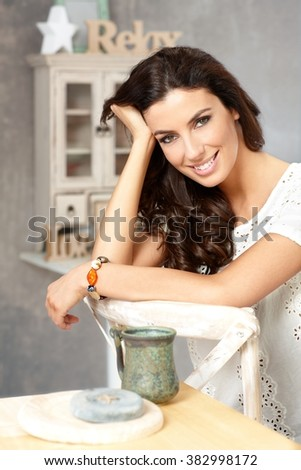 Portrait of beautiful young woman smiling in retro home. - stock photo