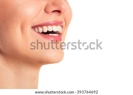 Portrait of beautiful young woman smiling, isolated on a white background, cropped - stock photo