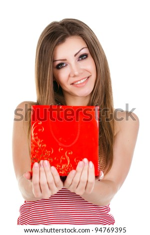 Portrait of beautiful young woman with a gift in her hands isolated - stock photo