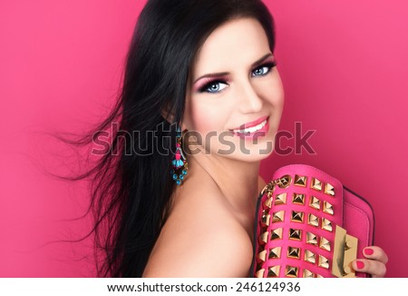 Portrait of beautiful young woman with bag - stock photo