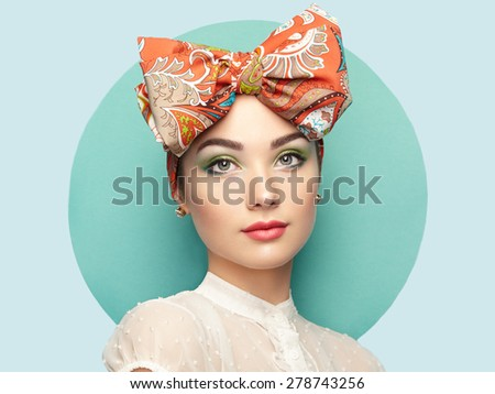 Portrait of beautiful young woman with bow. Brunette girl. Beauty fashion. Cosmetic make-up - stock photo