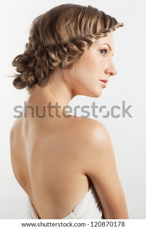 Portrait of beautiful young woman with creative braid hairdo