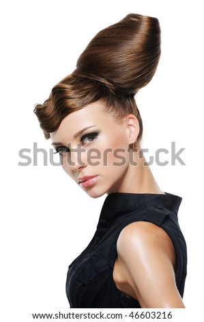 portrait of beautiful young woman with creative fashion hairstyle - stock photo