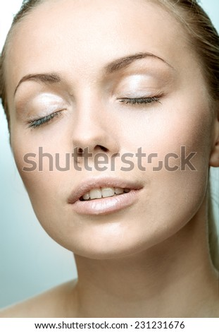 Portrait of beautiful young woman with drops of water around her face - stock photo