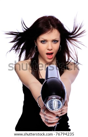 portrait of beautiful young woman with fashion hairstyle holding hairdryer