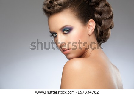 Portrait of beautiful young woman with fashion makeup and beautiful hairstyle
