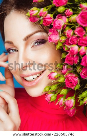 Portrait of Beautiful Young Woman with Flowers. Healthy Long Hair  - stock photo