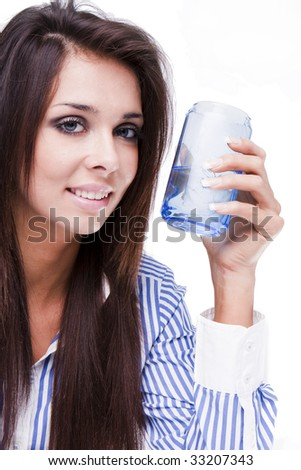 Portrait of beautiful young woman with glass of water - stock photo