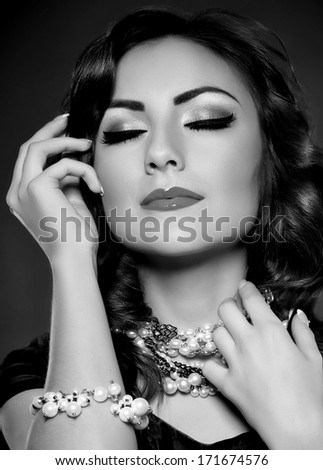 Portrait of beautiful young woman with golden jewelry  - stock photo
