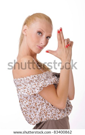 portrait of beautiful young woman with hands pointing like a gun