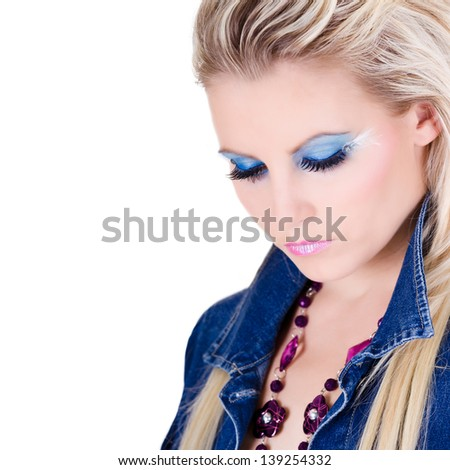 Portrait of beautiful young woman with long blond hair - stock photo