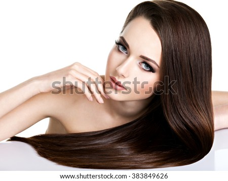 Portrait of beautiful young woman with long straight brown hair isolated on white - stock photo