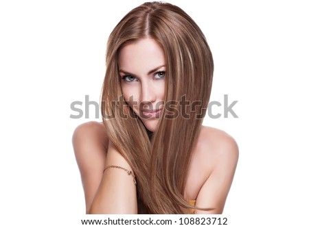Portrait of beautiful young woman with long straight brown hair posing isolated on white background