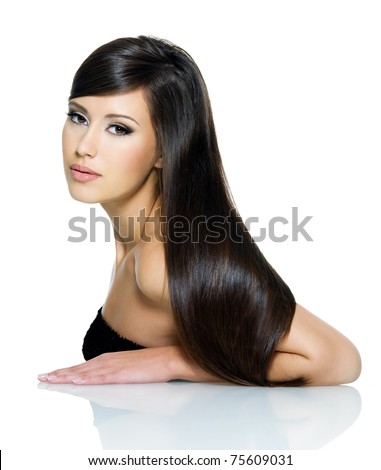 Portrait of beautiful young woman with long straight brown hair posing isolated on white background - stock photo