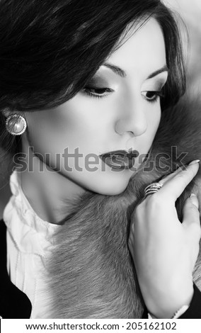 Portrait of beautiful young woman with makeup - stock photo