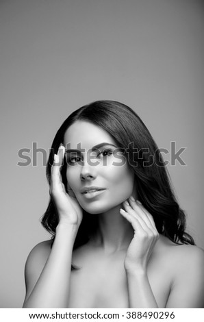 portrait of beautiful young woman with naked shoulders, black and white, with copyspace - stock photo