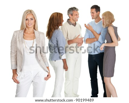 Portrait of beautiful young woman with people discussing in background - stock photo