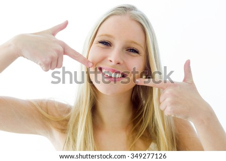 Portrait of beautiful young woman with perfect smile. Isolated on white. - stock photo
