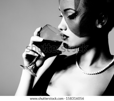 portrait of beautiful young woman with wine glass, black and white retro stylization - stock photo