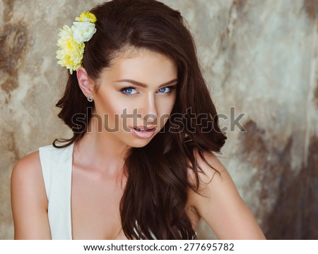 Portrait of Beautiful Young Woman with Yellow Flowers. Healthy Long Hair and Clear Skin. Close Up - stock photo