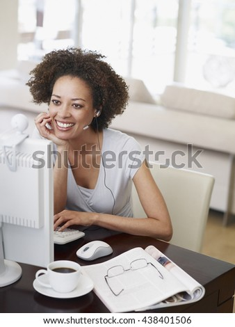 Portrait of beautiful young woman working at computer at home