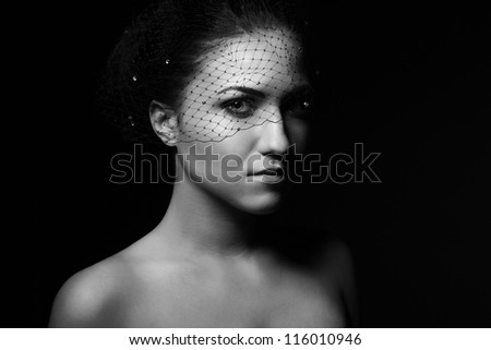 Portrait of beautiful young women in veil closeup - stock photo