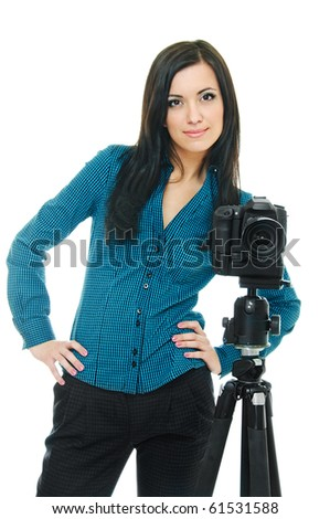 portrait of beauty brunette with tripod and camera on white - stock photo