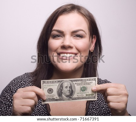 portrait of beauty girl with money close up