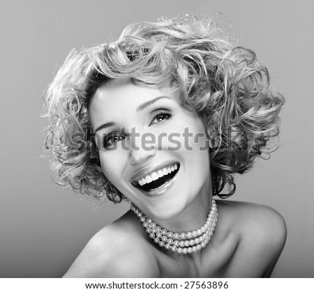 Portrait of beauty laughing young woman - black and white image - stock photo
