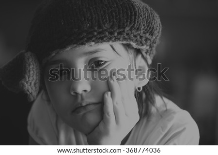 Portrait of beauty school aged brunette kid girl with black eyes indoor in black and white edition - stock photo