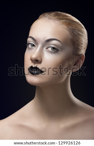 portrait of beauty sexy young girl with blonde smooth hair, white eye make-up, black lipstick and black background
