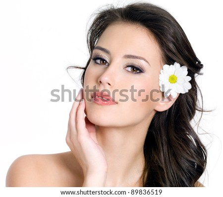 Portrait of beauty woman with beautiful face and flower in hair- white background - stock photo