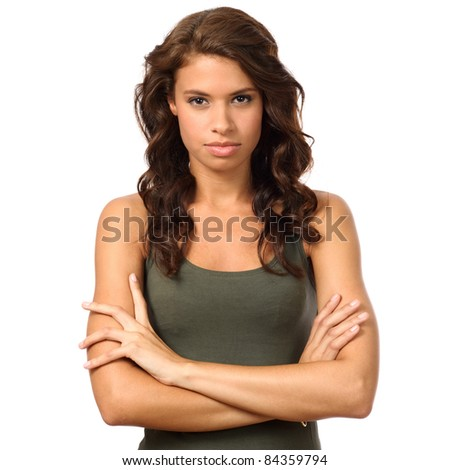 Portrait of beauty young woman with arm crossed and looking strong at camera - stock photo