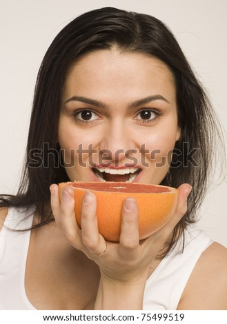 portrait of beauty young woman with grapefruit isolated