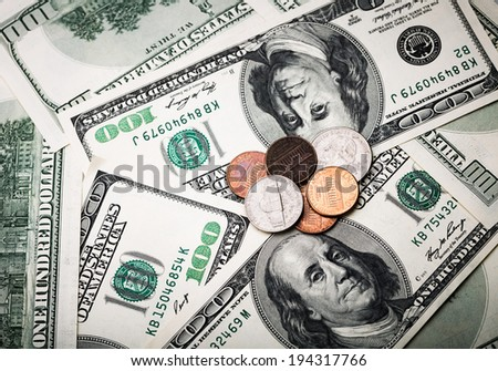 Portrait of Benjamin Franklin from one hundred dollars banknote and cents coins shots in macro lens close-up - stock photo