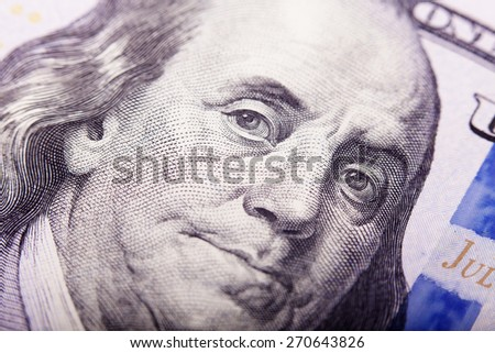 Portrait of Benjamin Franklin from one hundred dollars bill new edition closeup conceptual background  - stock photo
