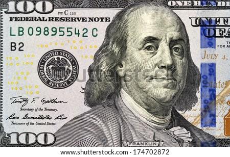 Portrait of Benjamin Franklin from one hundred dollars bill new edition macro - stock photo