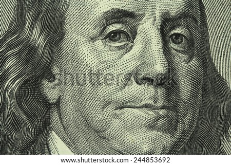 portrait of Benjamin Franklin on the hundred dollar bill closeup - stock photo