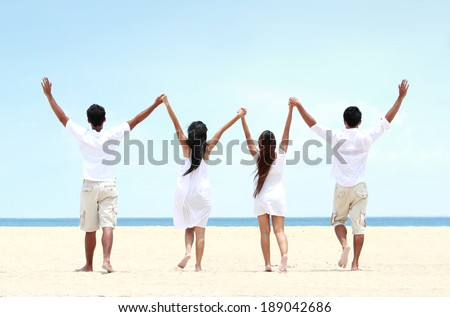 Portrait of best friend in white together holding and raise each other hand