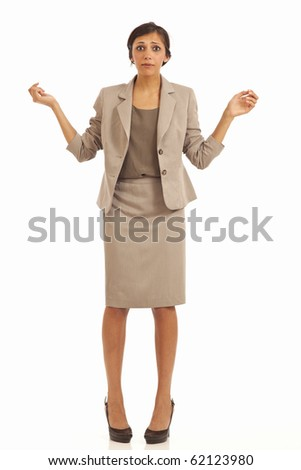 Portrait of bewildered young business woman - stock photo