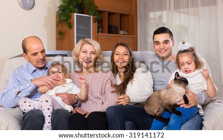 Portrait of big happy multigenerational family on sofa at home