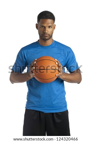 Portrait of black american man holding a basketball near his chest - stock photo