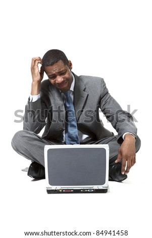 portrait of black businessman with laptop over white background