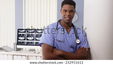 Portrait of black male medical doctor in hospital - stock photo