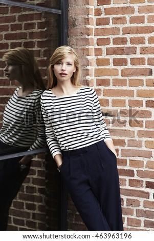 Portrait of blond and beautiful woman in striped top