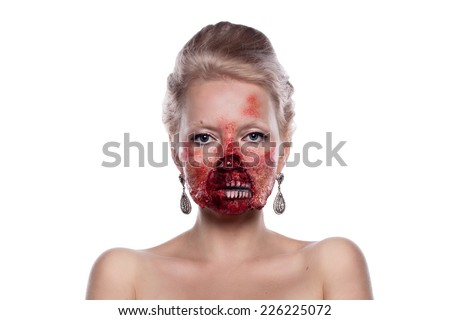 Portrait of blond bloody zombies in a festive makeup, isolated on white background