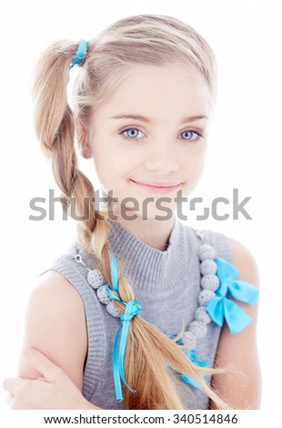 Portrait of blond little girl with blue eyes. Isolated on white background. - stock photo