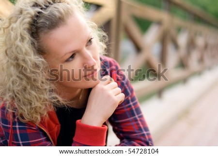 portrait of blond unhappy woman - stock photo
