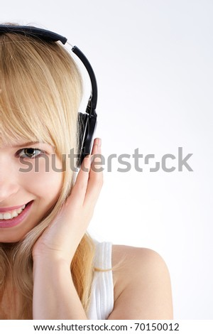 Portrait of blond who listens to music