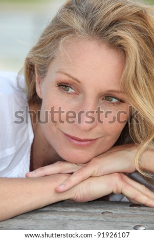 Portrait of blond woman - stock photo